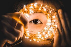 Start Now - eye through circle of fairy lights
